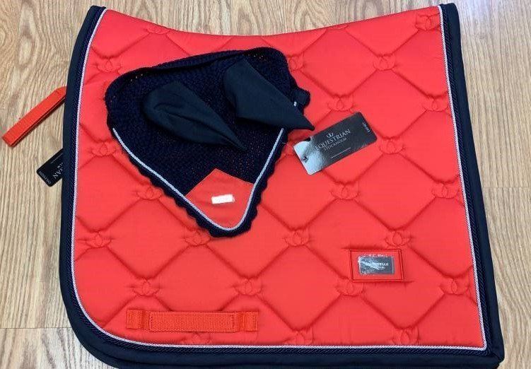 Equestrian Stockholm dressage saddle pad and ear net at Cheshire Equestrian Center